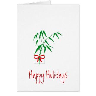 Bambú y tarjeta de felicitación roja del día de fi