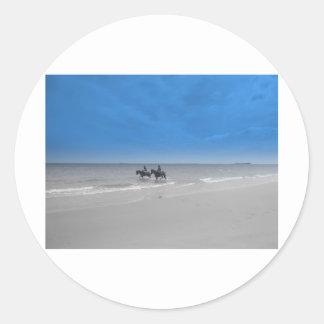 bamburgh beach round sticker