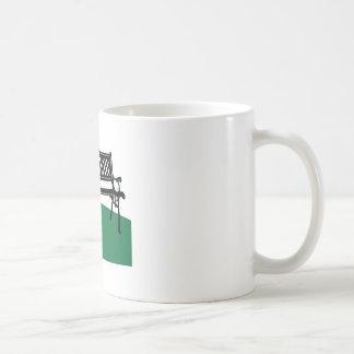 Banco de parque tazas de café