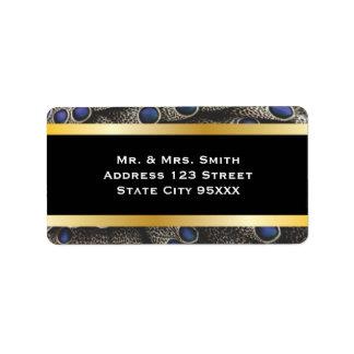 Bandas del modelo y del oro del pavo real etiquetas de dirección