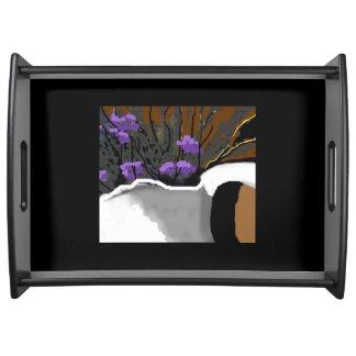 Bandeja floral de la porción con las flores