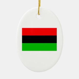 Bandera afroamericana adorno navideño ovalado de cerámica