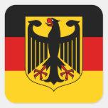 Bandera alemana con el pegatina del escudo (cuadra