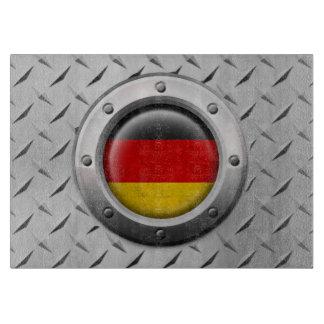 Bandera alemana industrial con el gráfico de acero tabla para cortar