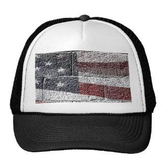 Bandera americana pintada en textura de la pared gorros