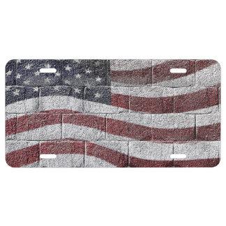 Bandera americana pintada en textura de la pared placa de matrícula