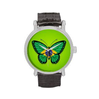 Bandera brasileña de la mariposa en verde reloj