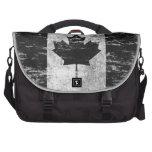 Bandera canadiense rascada y llevada, negra bolsas de portatil