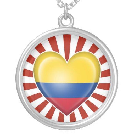 Bandera colombiana del corazón con la explosión de colgante