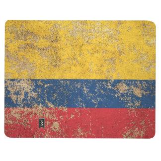 Bandera colombiana envejecida áspera del vintage cuaderno grapado