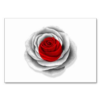 Bandera color de rosa japonesa en blanco