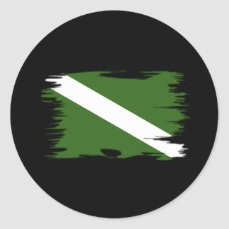 Bandera coloreada enrrollada de la zambullida etiqueta redonda