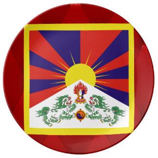 Bandera de lujo de Tíbet en fondo rojo del Plato De Cerámica