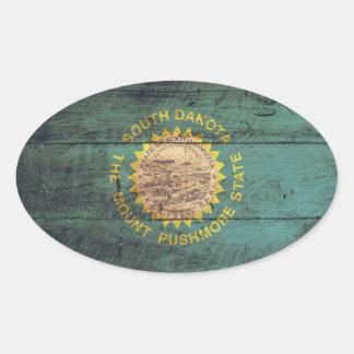 Bandera de madera vieja de Dakota del Sur Pegatina Ovalada