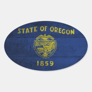 Bandera de madera vieja de Oregon; Pegatina Ovalada