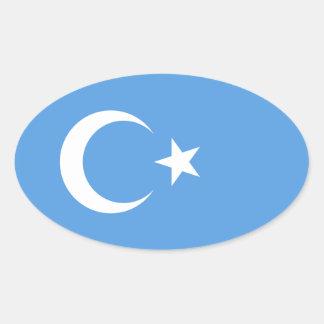 Bandera del este de CUATRO Turkestan Uyghur Pegatina Ovalada