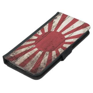 Bandera del sol naciente de Japón en grano de