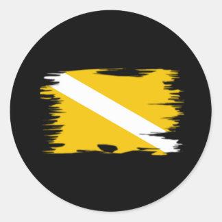 Bandera enrrollada de la zambullida del color etiqueta