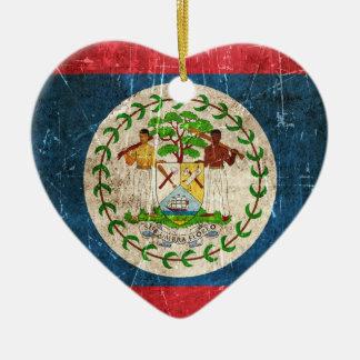 Bandera envejecida y rasguñada del vintage de adorno navideño de cerámica en forma de corazón