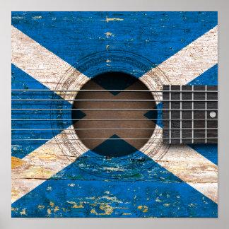 Bandera escocesa en la guitarra acústica vieja posters