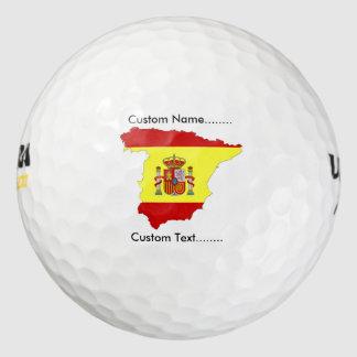 Bandera española con el emblema español en una pack de pelotas de golf