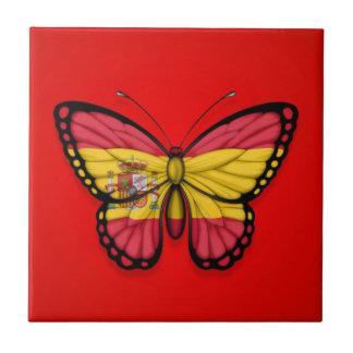 Bandera española de la mariposa en rojo tejas