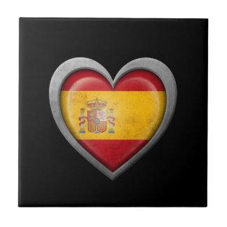 Bandera española del corazón con efecto del metal azulejos