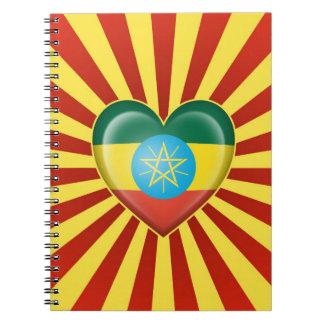 Bandera etíope del corazón con los rayos de Sun Libro De Apuntes Con Espiral