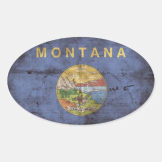 Bandera gastada de Montana Calcomanía Oval Personalizadas