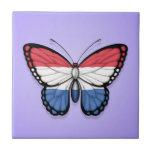 Bandera holandesa de la mariposa en púrpura tejas  ceramicas