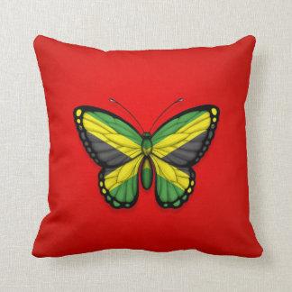 Bandera jamaicana de la mariposa en rojo cojin