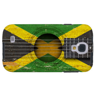 Bandera jamaicana en la guitarra acústica vieja