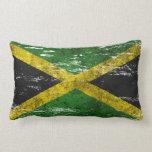 Bandera jamaicana rascada y llevada cojines