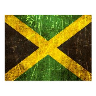 Bandera jamaicana rasguñada y llevada del vintage tarjeta postal