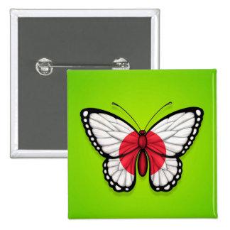 Bandera japonesa de la mariposa en verde pins