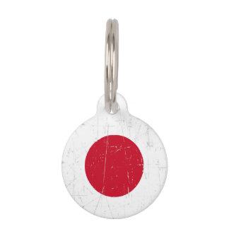 Bandera japonesa rascada y rasguñada identificador para mascotas