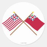 Bandera magnífica cruzada del rojo de la bandera pegatina redonda