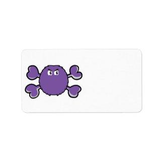 bandera pirata borrosa de la púrpura del cráneo de etiquetas de dirección