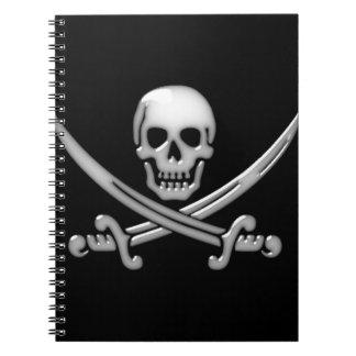Bandera pirata del cráneo y de la espada del libro de apuntes con espiral