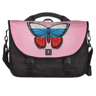 Bandera rusa de la mariposa en rosa bolsas de ordenador