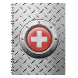 Bandera suiza industrial con el gráfico de acero libro de apuntes