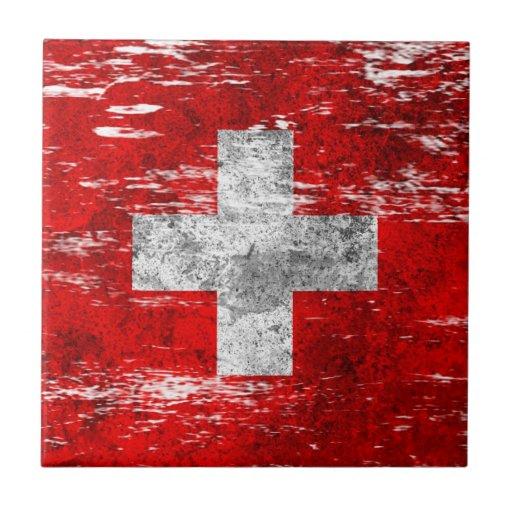 Bandera suiza rascada y llevada azulejos