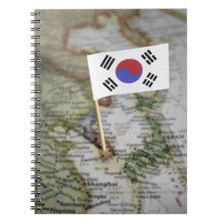 Bandera surcoreana en mapa libretas