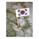 Bandera surcoreana en mapa postales