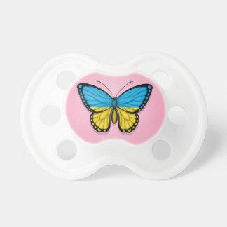 Bandera ucraniana de la mariposa en rosa chupetes para bebés