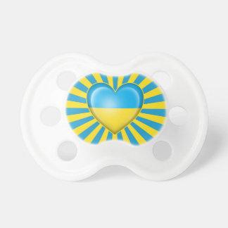 Bandera ucraniana del corazón con la explosión de  chupetes