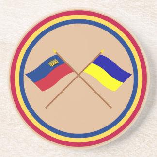 Banderas cruzadas de Liechtenstein y de Triesenber Posavasos De Arenisca