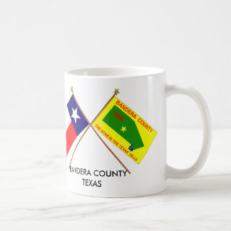 Banderas cruzadas de Tejas y del condado de Bander Taza