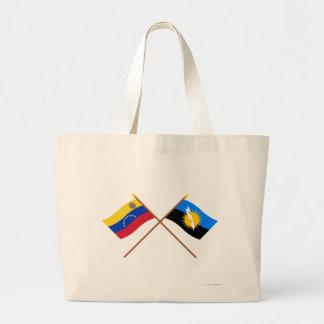 Banderas cruzadas de Venezuela y de Zulia Bolsa