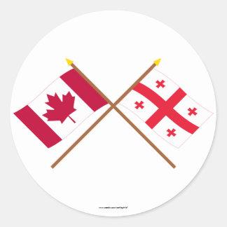Banderas cruzadas república de Canadá y de Georgia Pegatina Redonda